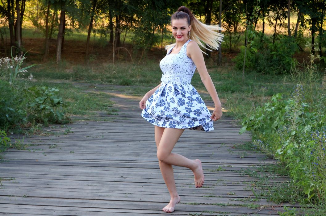 Woman in Blue and White Skated Dress wallpaper