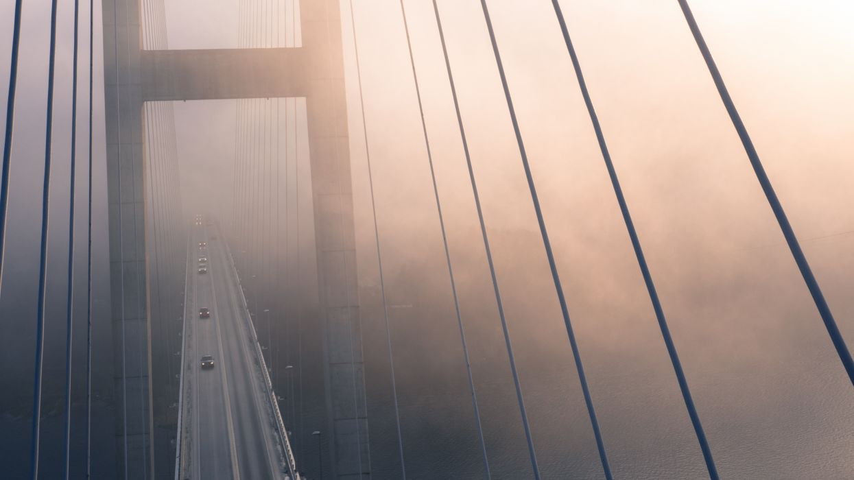 architecture blur bridge city close-up construction contemporary dark dawn evening fog light mist modern steel steel and concrete structure suspension bridge suspension cables travel urban wallpaper