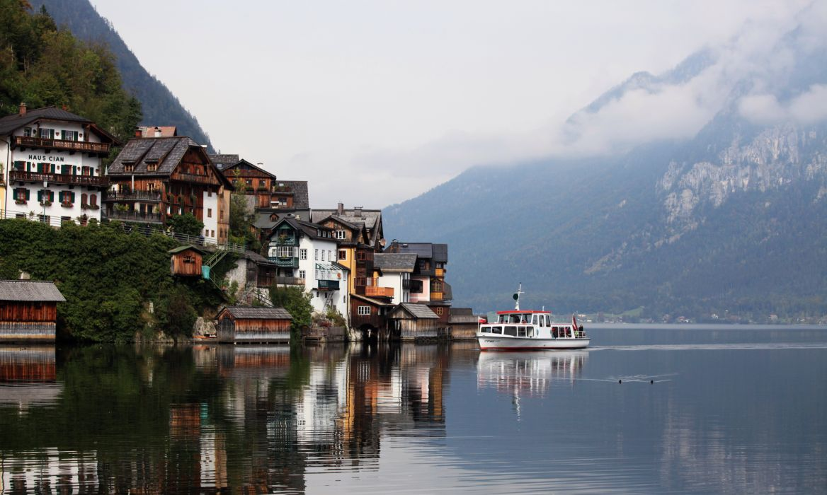 architecture boat buildings clouds daylight houses lake landscape mountains outdoors reflections sight travel trees view water watercraft waterfront wallpaper