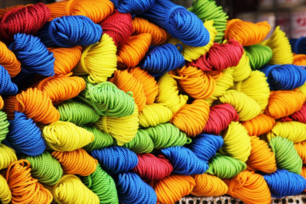 colorful colourful cords creative fibers rolled stacked threads wool yarn wallpaper