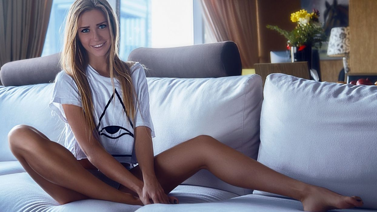 Sensuality sensual sexy woman girl model legs feet barefoot sitting-couch pillows smiling wallpaper