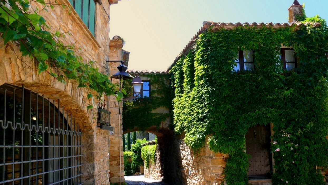Ivy covered houses in catalonia spain wallpaper