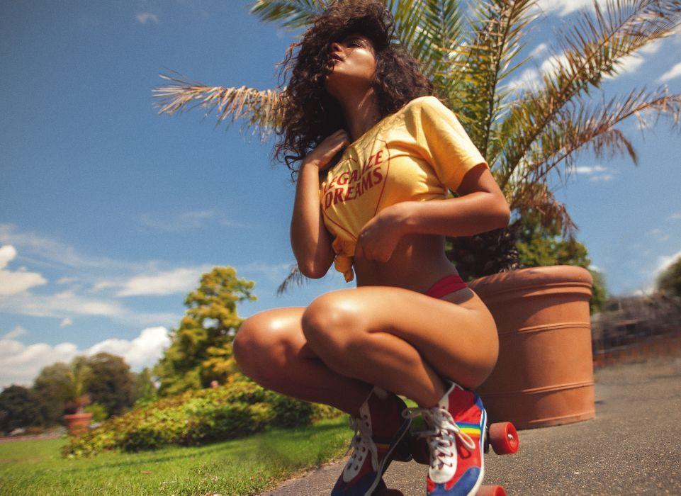 Sensuality sensual sexy girl woman model bikini tanned legs squatting t-shirt rollerskates thong Vanety-Cassia wallpaper
