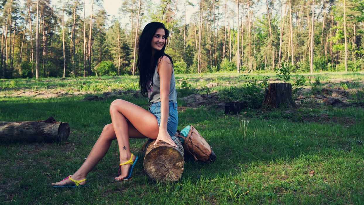 Sensuality sensual sexy girl woman model shorts jeans denim t-shirt legs flip flop nature bag smiling sitting trees grass wallpaper