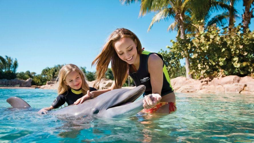 Photography girl woman caress love dolphin animals chidren bikini sea bach trees wallpaper
