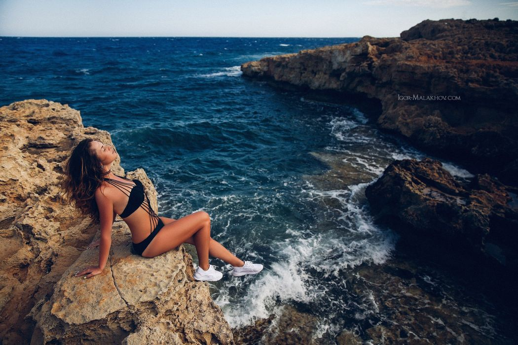Photography sensuality sensual sexy girl woman model legs knees bikini tanned sea sitting sneakers rocks wallpaper