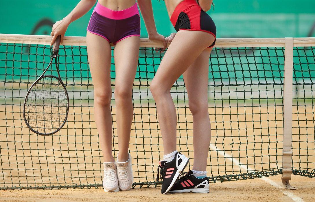 Sport sensuality sensual sexy girl woman exercise legs knees stretching sneakers sport-waer shorts tennis racket net skinny wallpaper