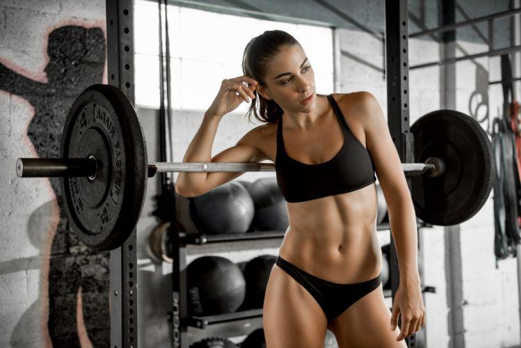 Sport sensuality sensual sexy girl woman model body fitness workout sportswear belly abs navel gym Dani-Dikeman bra dumbbells wallpaper
