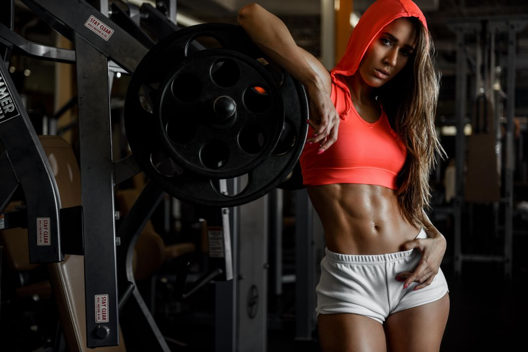 Sport sensuality sensual sexy girl woman model body fitness workout sportswear belly abs navel gym dumbbells shorts sweat sweaty hood piercing Dani Dikeman wallpaper
