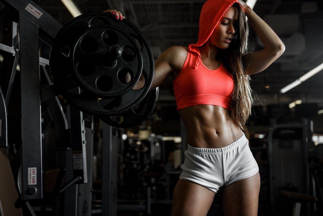 Sport sensuality sensual sexy girl woman model body fitness workout sportswear belly abs navel gym dumbbells shorts sweat sweaty hood piercing pose Dani-Dikeman wallpaper