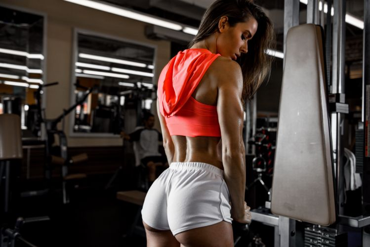 Sport sensuality sensual sexy girl woman model body fitness workout sportswear belly abs navel gym dumbbells shorts sweat sweaty hood Dani-Dikeman wallpaper