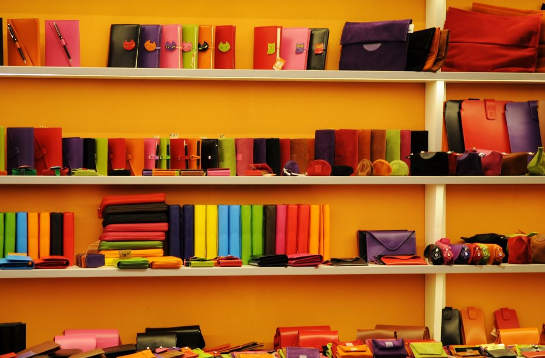accessory books cases colorful colourful library purses retail sales sell shelf shop store wallets wallpaper