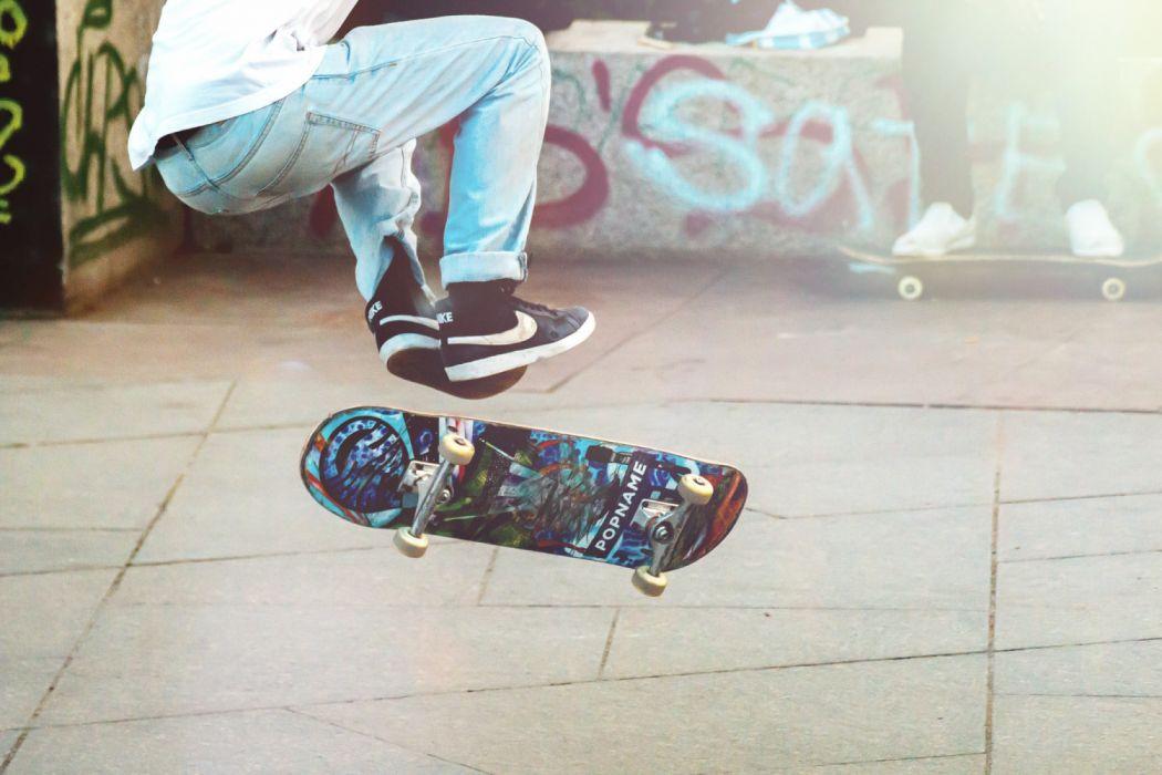 action adult board boy city deck fun graffiti guy jump man motion outdoors pavement person road shoes skate skateboard wallpaper