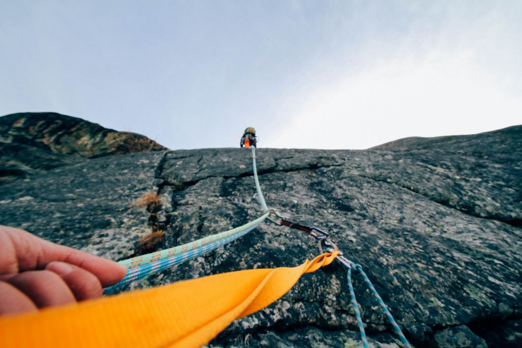 action adventure climbing daylight hand help landscape leisure low angle shot mountain outdoors person recreation rock rope sport summer support travel wallpaper
