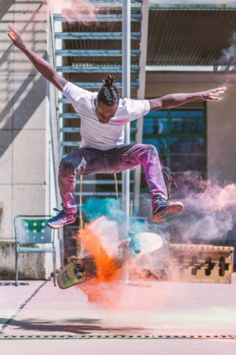 action adult balance balancing city colorful concentration daylight fun holi powder human jump jump shot leisure lifestyle light male wallpaper