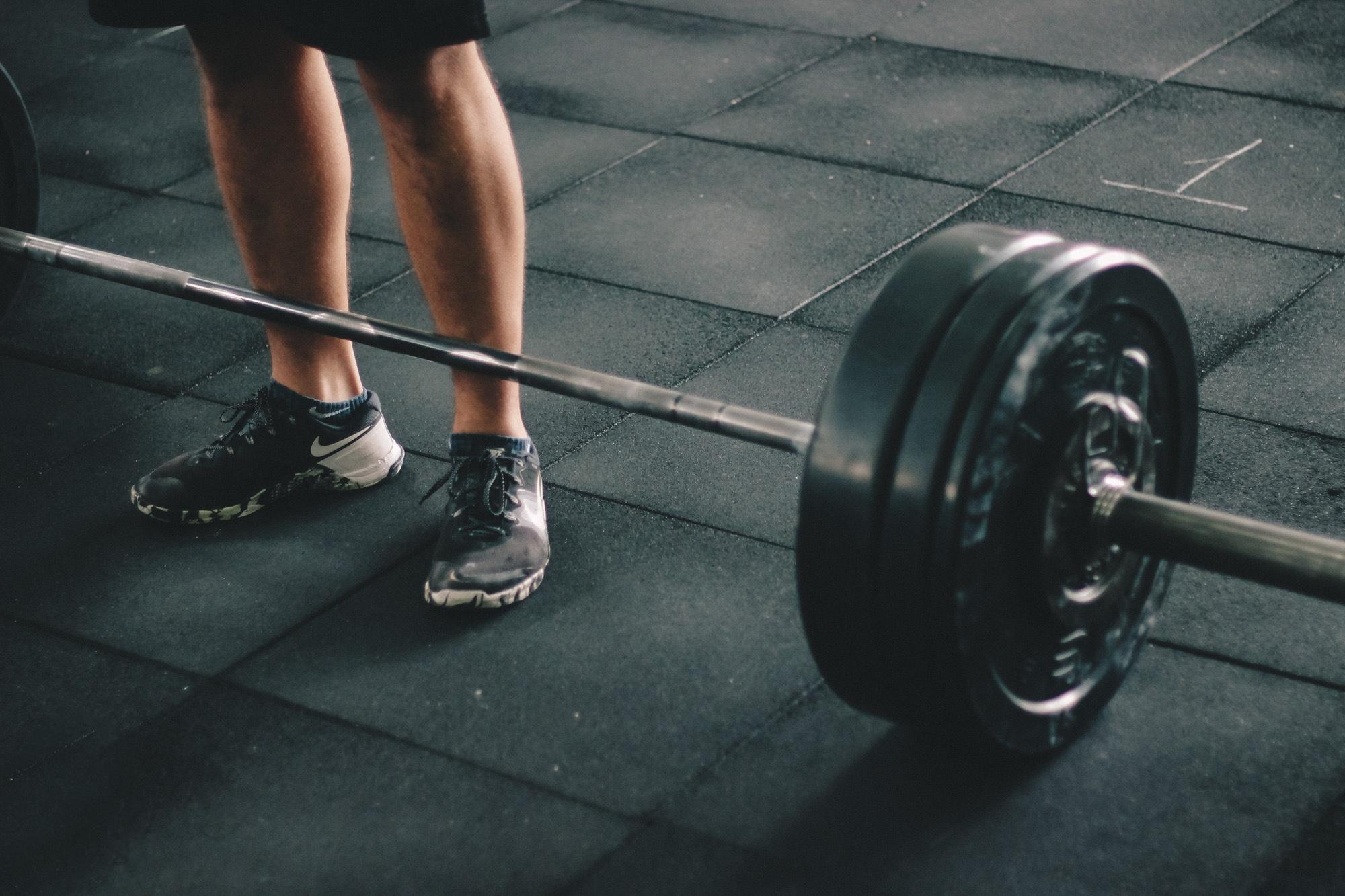 adult athlete barbell body bodybuilder bodybuilding brawny crossfit dark dumbbell exercise exercise equipment fitness footwear gym