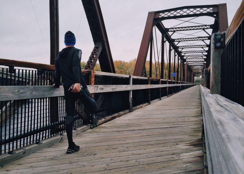 adult architecture athlete boardwalk bridge daytime exercise fit fitness footbridge health man outdoors person railings recreation run wallpaper