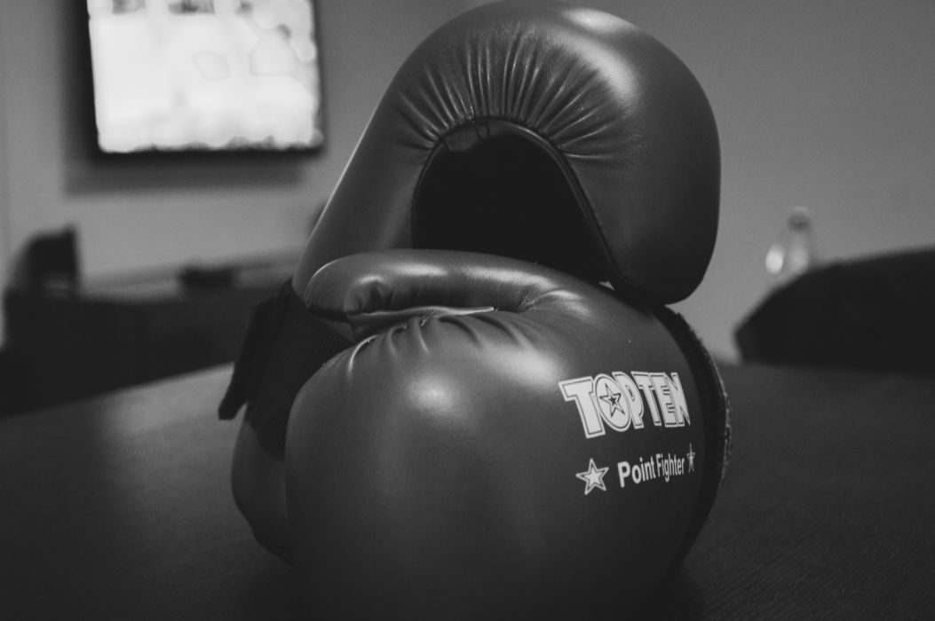 athlete black-and-white boxer boxing gloves close-up gloves indoors portrait recreation sport sports equipment still life strength topten wallpaper