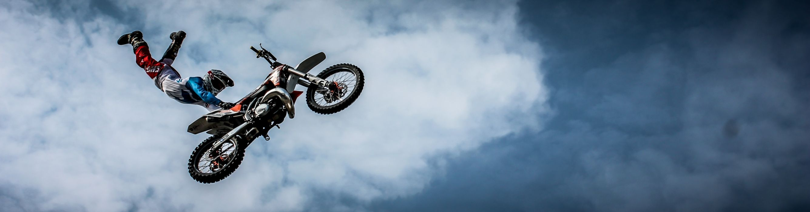 bike biker clouds extreme jumping motocross motorbike motorcycle panoramic person sky sport wallpaper