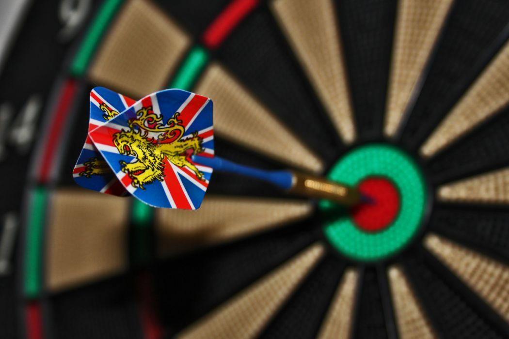 Blue Brown Dart on Red Green Black Dartboard wallpaper