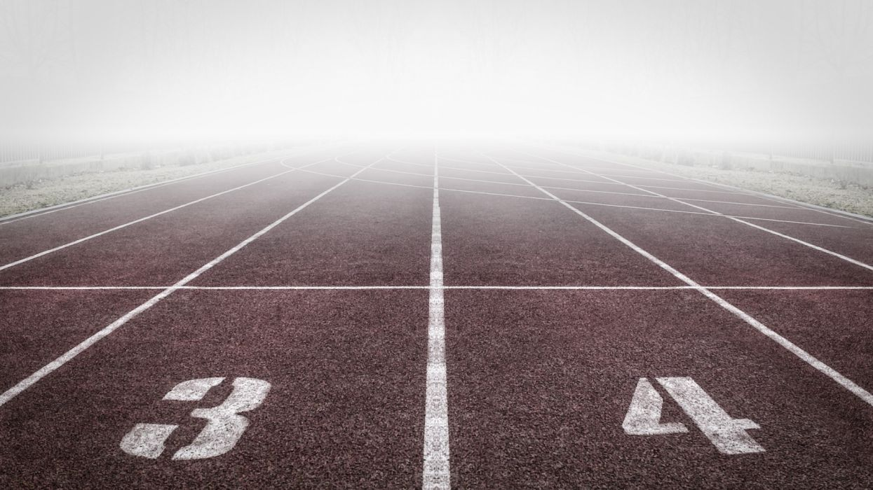 Brown and White Track Field wallpaper