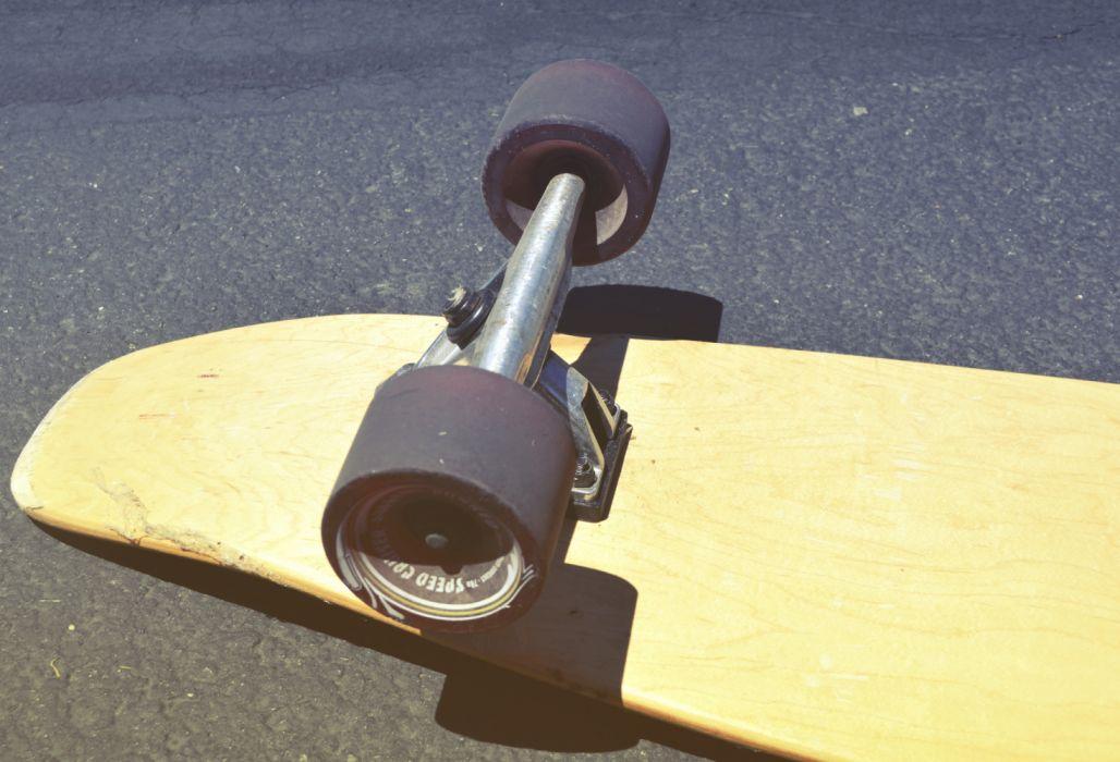 Brown Skateboard on Concrete Road wallpaper