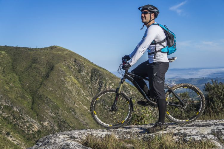 Man With White Shirt Riding Abicycle on a Mountain wallpaper