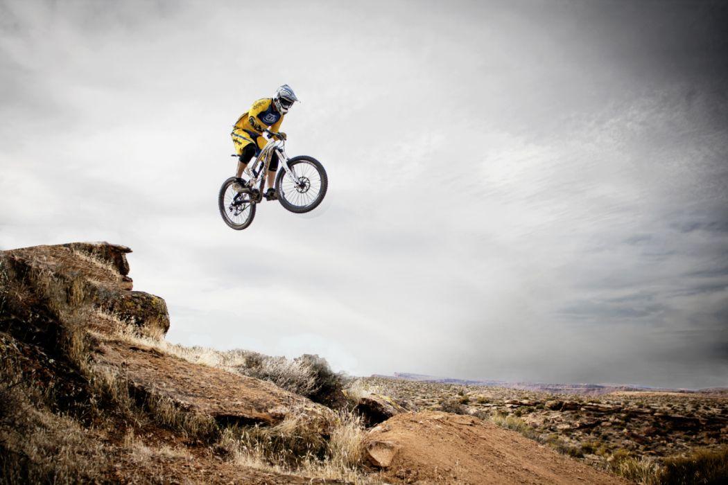 Person Riding Bike Making Trek on Thin Air wallpaper