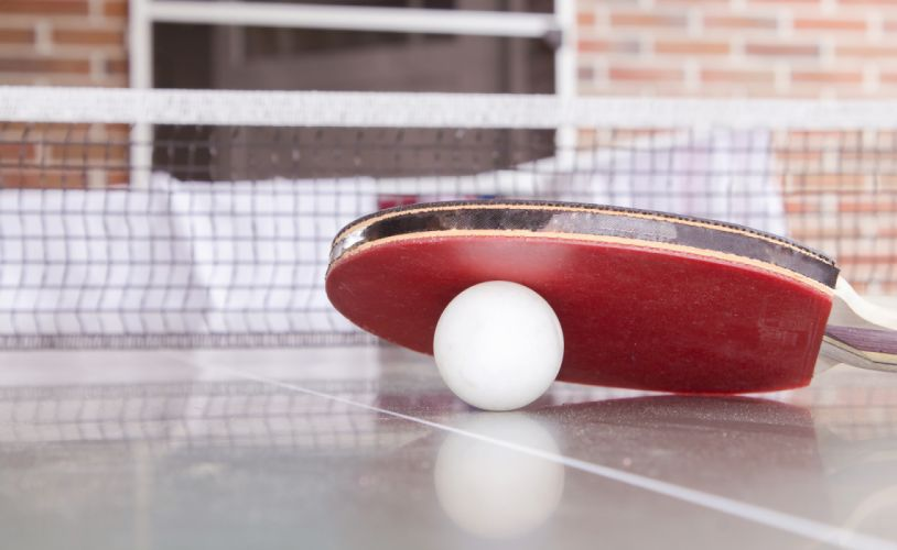 White Pingpong Ball Beneath Red Table Tennis Paddle wallpaper