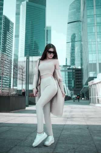 adult architecture buildings city cityscape clothing face fashion female girl glasses hair hairstyle hands legs long hair modern pants person shoes wallpaper