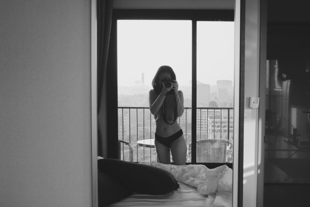 adult bedroom black-and-white door female furniture girl indoors lady person room window woman young wallpaper