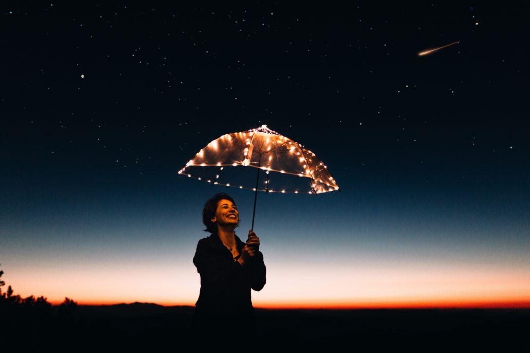 astronomy dark dawn dusk girl happiness horizon illuminated joy lady light luminescence night person sky smiling stars umbrella woman wallpaper