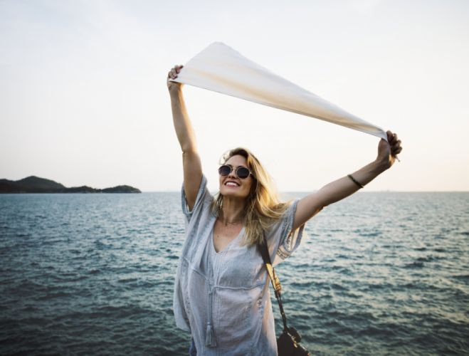beautiful blonde clear sky freedom girl happiness happy ocean sea shirt sky smile woman young wallpaper
