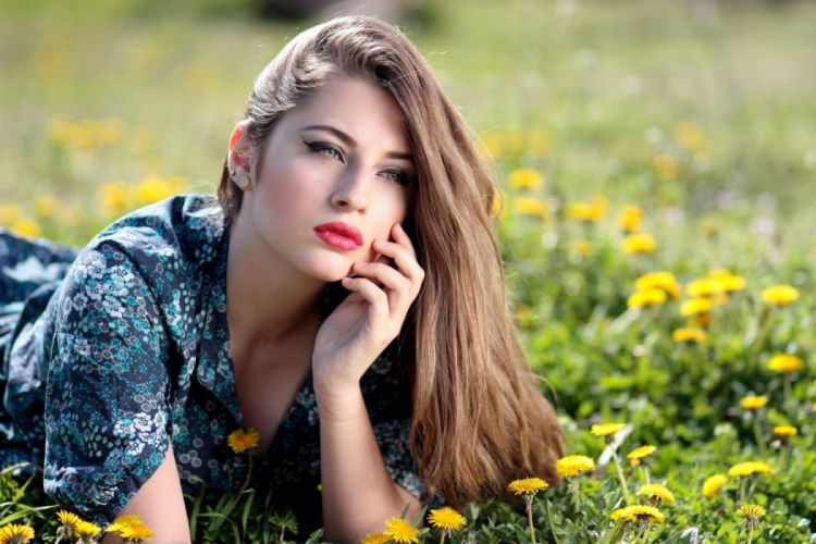 Girl Lying on Yellow Flower Field during Daytime wallpaper