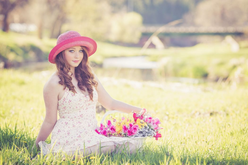 Portrait of a Beautiful Young Woman in Field wallpaper