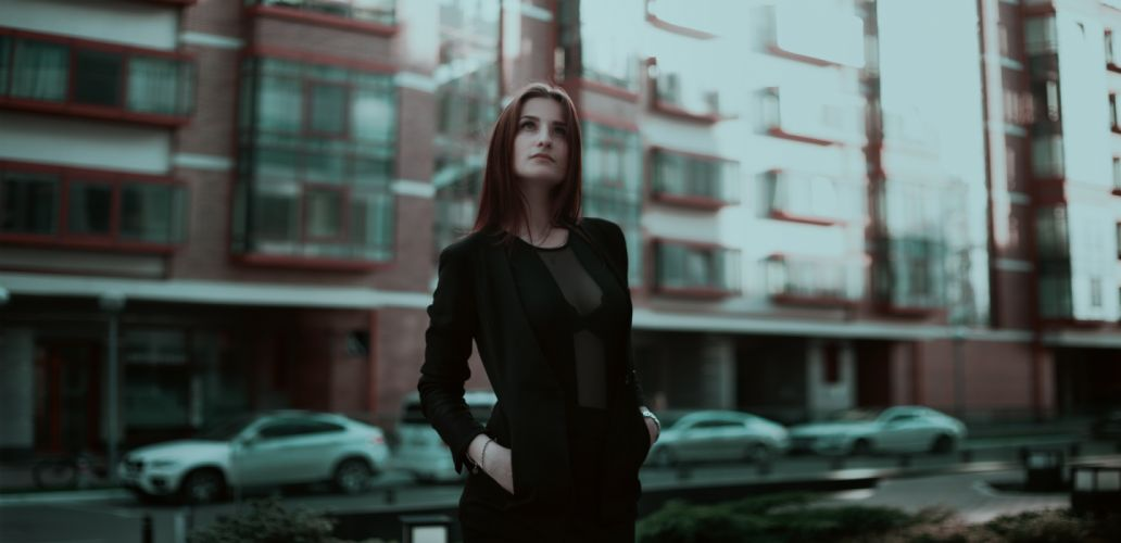 Woman Standing Looking Up wallpaper