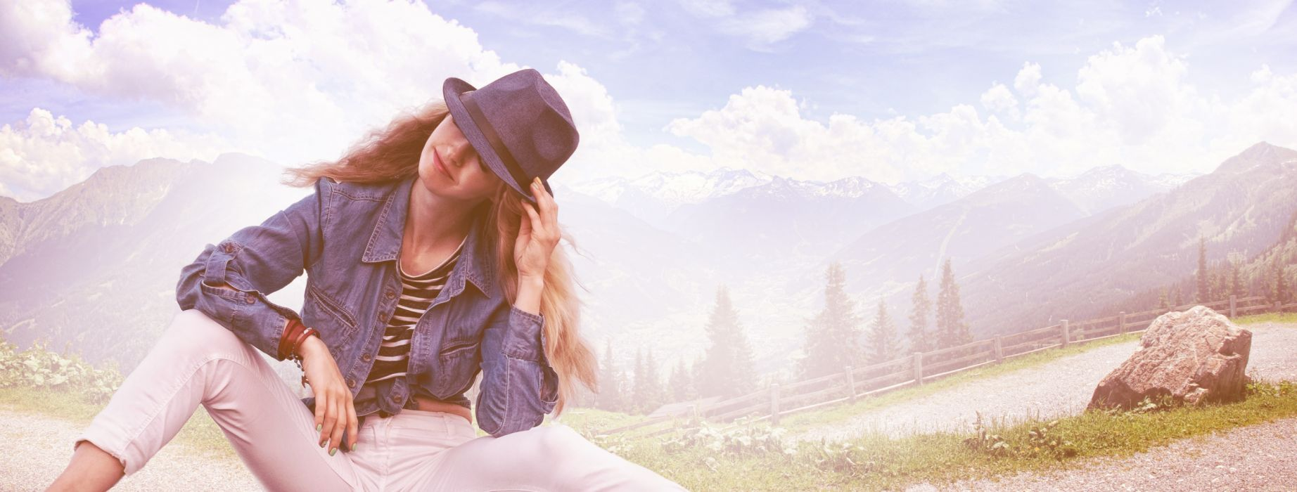 Woman Wearing Black Fedora Hat Blue Denim Blazer and White Skinny Jeans While Sitting on Ground wallpaper