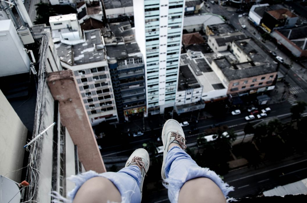 Photography sensuality sensual-sexy girl woman model legs knees jeans ripped torn sneakers sky city urban wallpaper