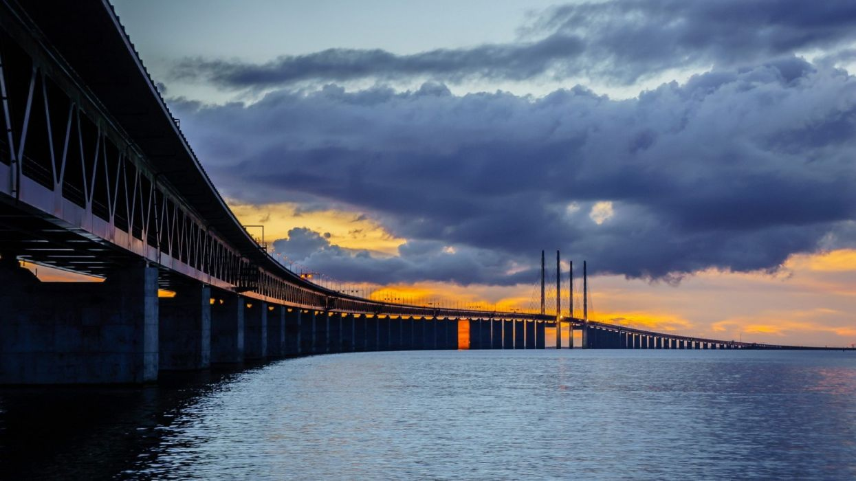 sunset-sea-clouds-bridge-sky wallpaper