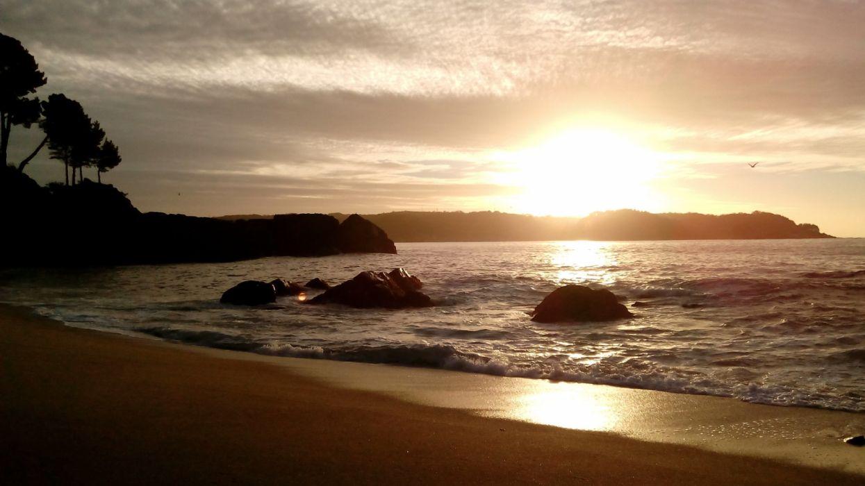 puesta sol playa mar amanecer wallpaper