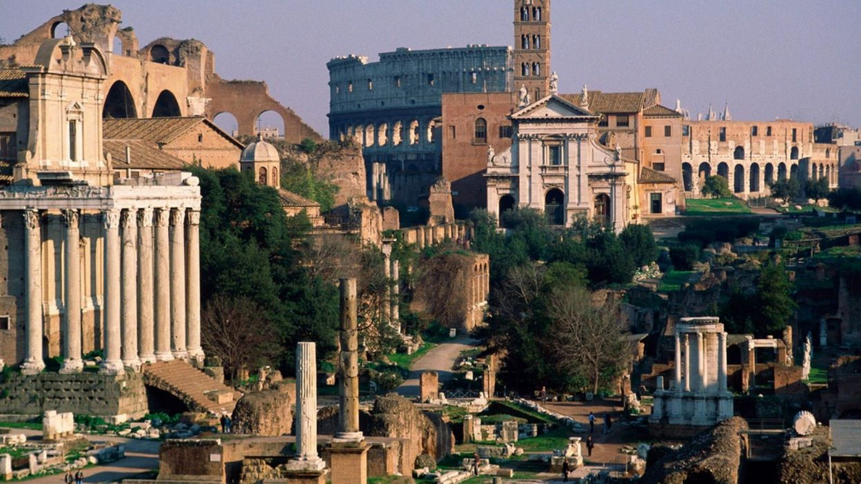 brown concrete building with columns Rome Italy Ancient Rome wallpaper