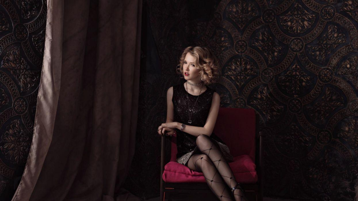 Ilya Novitsky sitting on chair wallpaper