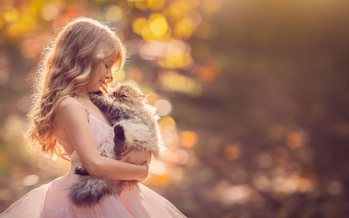 Cute blonde little girl and kitten friends wallpaper