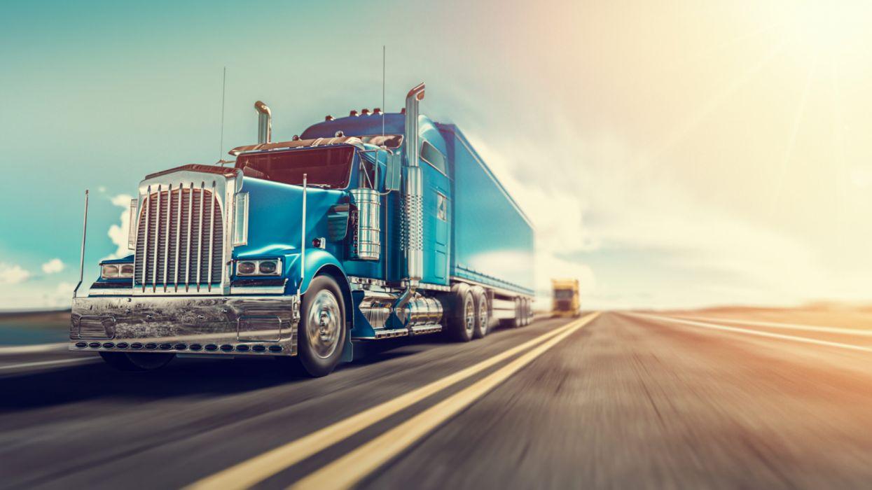 blue semi truck on highway wallpaper
